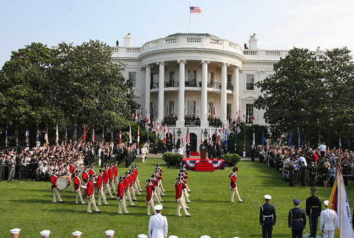The U.S. Army Old Guard Fife and Drum Corps marches across the South Lawn during the official arrival ceremony for Prime Minister Junichiro Koizumi of Japan Thursday, June 29, 2006.